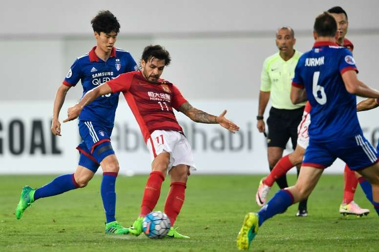 Goulart double puts Evergrande into knock-outs