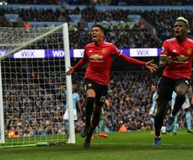 Chris Smalling completed an incredible comeback as United beat City 3-2 last season. AFP
