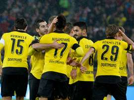 Dortmund players celebrate after they score the opening goal during the German Cup quarter final football match at VfB Stuttgart on February 9, 2016