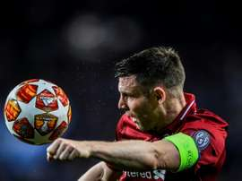 James Milner in Champions League action for Liverpool. AFP