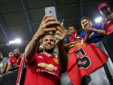 Mata's goal salvaged a draw for United. AFP