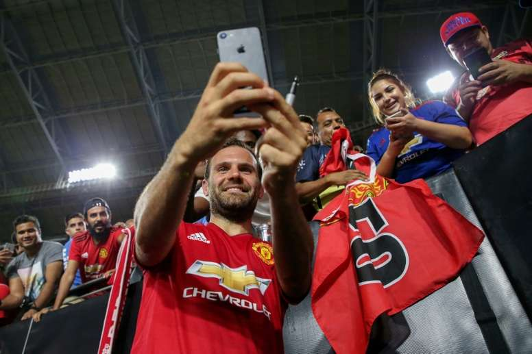 Juan Mata of Manchester United takes photos with fans after their International Champions Cup game against the Club America, at the University of Phoenix Stadium in Glendale, Arizona, on July 19, 2018