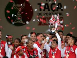 Sporting Bragas players hold the trophy after wining the Portuguese Cup final football match FC Porto vs SC Braga at the Jamor stadium in Oeiras, outskirts of Lisbon, on May 22, 2016