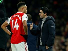 Aubameyang (L) strongly denies claims he is looking to leave Arsenal. AFP