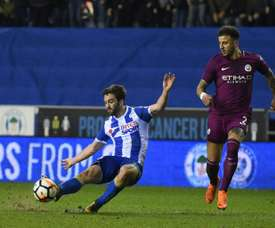 Grigg scored in Wigan's victory over City. AFP