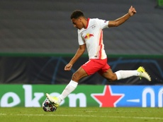 Tyler Adams' deflected strike saw Leipzig progress to the Champions League semi-finals. AFP