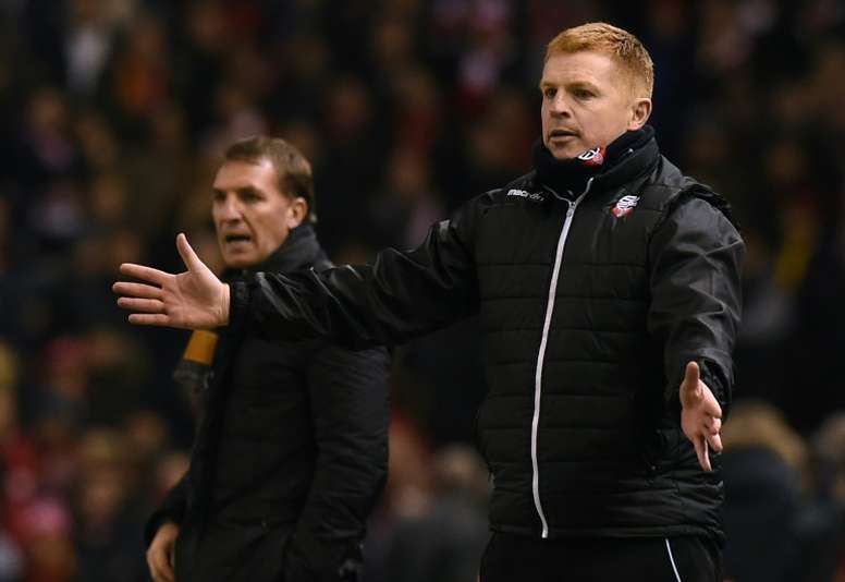 Rodgers and Lennon pictured during a FA Cup clash between Bolton and Liverpool. AFP