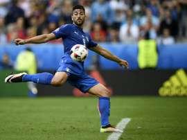 L'Italien Graziano Pelle marquant le deuxième but de son équipe durant Espagne-Italie à l'Euro. AFP