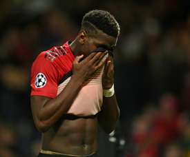 Paul Pogba looks dejects as United miss the chance to finish top. AFP