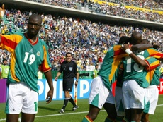 Papa Bouba Diop celebrates after a Camara goal against against Sweden at the 2002 World Cup. AFP