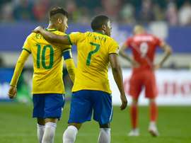 Brazils Douglas Costa (R) and Neymar (L), pictured on June 14, 2015, are heading a young Brazil Olympic football squad for the Rio Games