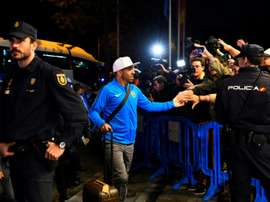 Carlos Tevez arrived in Madrid with the rest of his Boca Juniors team-mates on Wednesday. AFP