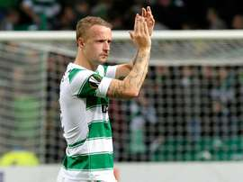 Celtics Scottish striker Leigh Griffiths applauds supporters on October 1, 2015