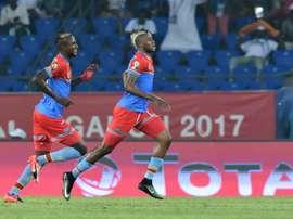 Democratic Republic of the Congos forward Junior Kabananga (R) celebrates with midfielder Merveille Bokadi after scoring a goal on January 16, 2017