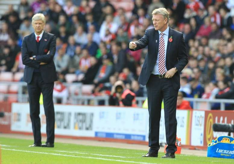 Arsene Wenger and David Moyes will meet on the touchline again on Wednesday. AFP