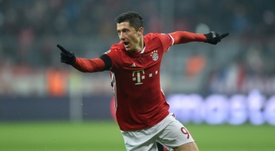 Robert Lewandowski celebrates scoring the opening goal against Atletico Madrid. AFP