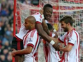 Sunderlands defender Lamine Kone (top) celebrates after scoring his teams third goal on May 11, 2016