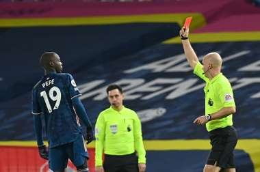 Arsenal held out for a 0-0 draw at Leeds despite Nicolas Pepe's (left) red card. AFP