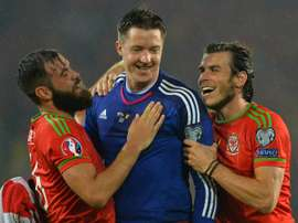 Wales players Gareth Bale (right) and Joe Ledley (left) celebrate with goalkeeper Wayne Hennessey after victory against Belgium in Cardiff on June 12, 2015