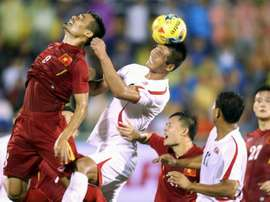 Nguyen Trong Hoang (left) plays for Vietnam against North Korea in Ho Chi Minh City last month