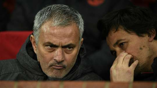 Jose Mourinho (L) talks with his assistant manager Rui Faria when the pair were at Man Utd.