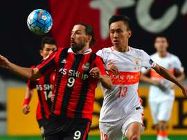 FC Seoul forward Dejan Damjanovic (left) fights for the ball with Shandong Luneng's Zhang Chi. AFP