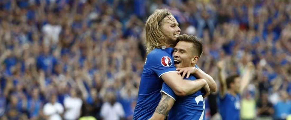 Icelands Arnor Ingvi Traustason (standing) celebrates scoring the winner against Austria. BeSoccer