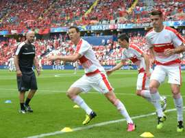 Switzerlands Stephan Lichtsteiner and Granit Xhaka (R) warm up ahead of their Euro 2016 Group A match against Albania, at the Bollaert-Delelis Stadium in Lens, on June 11, 2016