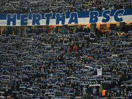 Supporters of Hertha salute their team before a German first division Bundesliga football match in Berlin, on March 2, 2016