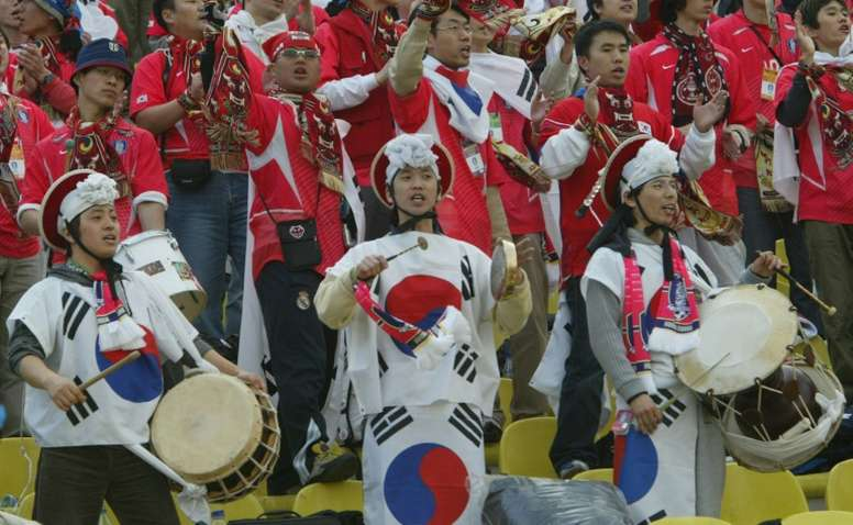 South Korean footbal fans enjoy a match on March 17, 2004