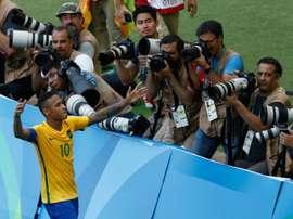 Neymar celebrates after scoring a penalty against Honduras. AFP