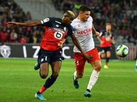 Nigeria forward Victor Osimhen claimed a late point for Lille . AFP