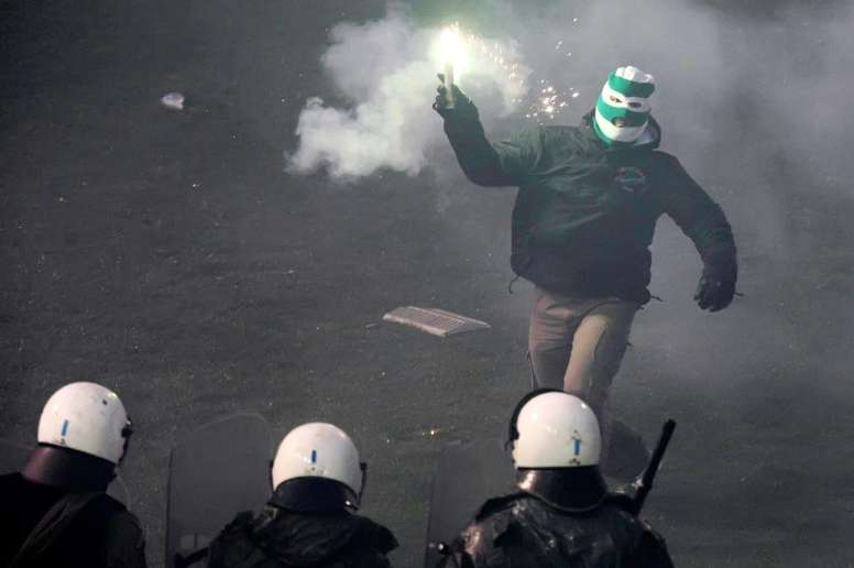Riot police clashes with football fans during the game between Athens arch-rivals Olympiakos and Panathinaikos on February 22, 2015 in Athens