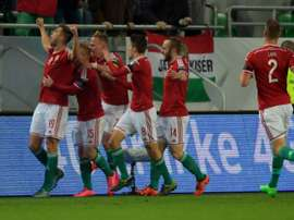 Hungarys forward Tamas Priskin (L) celebrates his goal against Norway during a Euro 2016 play-off match at the Grupama Arena in Budapest on November 15, 2015
