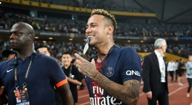 Neymar made his return for PSG in the Champions Trophy against Monaco in China. AFP