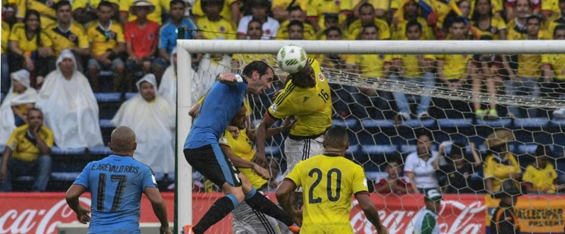 Uruguays Diego Godin (2nd L) and Colombias defender Yerry Mina (2nd R) jump for a header during their Russia 2018 FIFA World Cup qualifier football match in Barranquilla, Colombia, on October 11, 2016