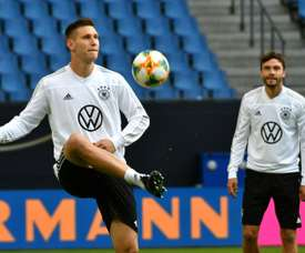 'Germany's van Dijk' - Suele learning to lead wobbly defence. AFP