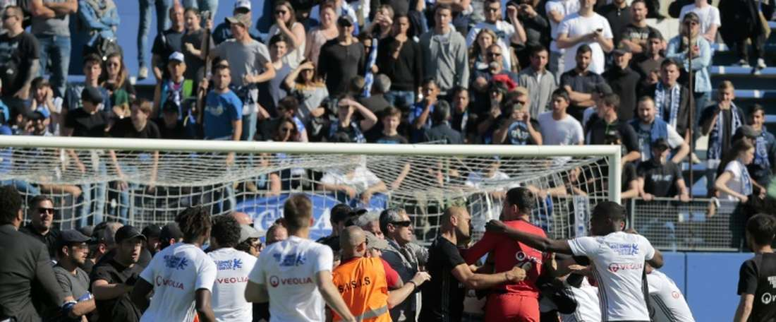 Lyon players file complaint after Bastia fan attacks. AFP