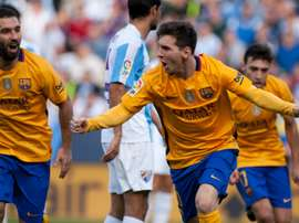 Barcelonas forward Lionel Messi celebrates after scoring during the Spanish league football match against Malaga at La Rosaleda stadium on January 23, 2016