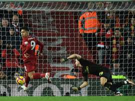 Roberto Firmino scores the first of his three goals. AFP