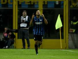 Inter Milan's forward Jonathan Biabiany celebrates after scoring during an Italian Serie A football match against Frosinone on November 22, 2015 at the San Siro Stadium stadium in Milan