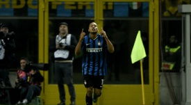Inter Milans forward Jonathan Biabiany celebrates after scoring during an Italian Serie A football match against Frosinone on November 22, 2015 at the San Siro Stadium stadium in Milan