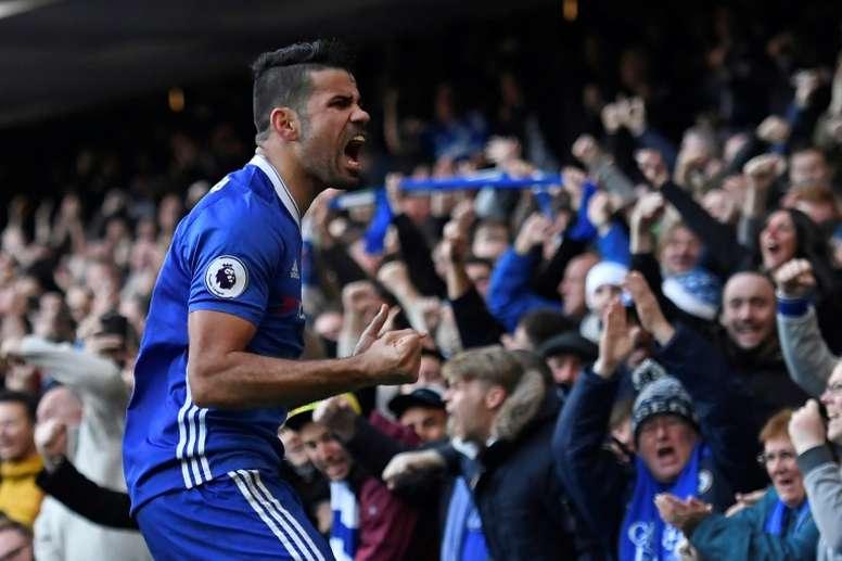 Chelseas striker Diego Costa celebrates after scoring on December 11, 2016