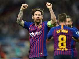 Messi celebrates victory against Tottenham Hotspur at Wembley. AFP