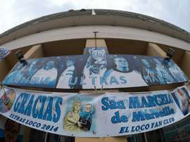 Banners picturing Marseilles former head coach Marcelo Bielsa are displayed outside a supporters club on August 10, 2015 in Marseille