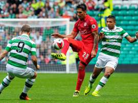 Celtics Scottish striker Leigh Griffiths (L) and Celtics Honduran defender Emilio Izaguirre (R) vie with Leicester Citys Argentinian striker Leonardo Ulloa (C) during match between Celtic and Leicester City in Glasgow, Scotland on July 23, 2016