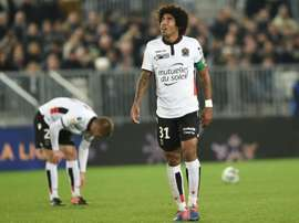 Nice defender Dante reacts (R) during their French League Cup match against Bordeaux. AFP