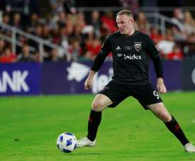 Rooney fires D.C. United to top as Crew downed.