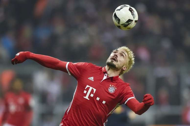 Bayern Munichs defender Mats Hummels in action during the German first division Bundesliga football match FC Bayern Munich vs RB Leipzig in Munich, Germany, on December 21, 2016