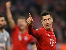 Lewandowski helps fire Bayern into Champions League last 16. AFP